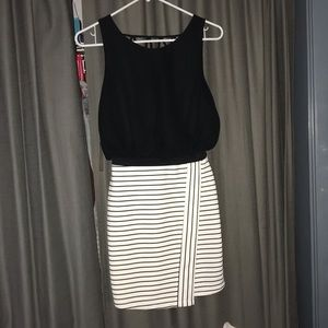 Black and white dress with open back.